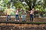 Children on a log Stock Photo - Premium Royalty-Free, Artist: Blend Images, Code: 6114-06610652