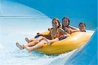 Girls on a water slide Stock Photo - Premium Royalty-Freenull, Code: 6114-06610656