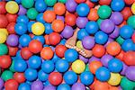 Feet in a ball pool Stock Photo - Premium Royalty-Free, Artist: Robert Harding Images, Code: 6114-06610664