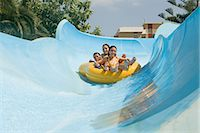 Friends on a water slide Stock Photo - Premium Royalty-Freenull, Code: 6114-06610667