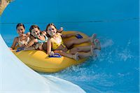 Girls on a water slide Stock Photo - Premium Royalty-Freenull, Code: 6114-06610669