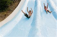Kids on a water slide Stock Photo - Premium Royalty-Freenull, Code: 6114-06610673