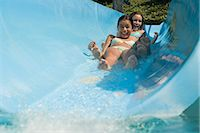 Girls on a water slide Stock Photo - Premium Royalty-Freenull, Code: 6114-06610675