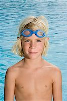 Boy wearing swimming goggles Stock Photo - Premium Royalty-Freenull, Code: 6114-06610677