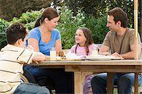 Family dining al fresco Stock Photo - Premium Royalty-Freenull, Code: 6114-06610747