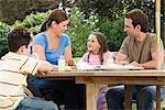 Family dining al fresco Stock Photo - Premium Royalty-Free, Artist: Blend Images, Code: 6114-06610747