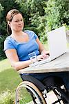 Woman working on laptop computer Stock Photo - Premium Royalty-Free, Artist: Zoran Milich, Code: 6114-06610765