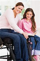 Mother and daughter with a book Stock Photo - Premium Royalty-Freenull, Code: 6114-06610766