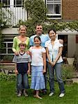 Japanese woman and english family in garden Stock Photo - Premium Royalty-Free, Artist: CulturaRM, Code: 6114-06610772