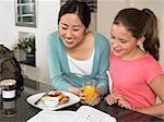 Exchange student and girl at breakfast Stock Photo - Premium Royalty-Free, Artist: GreatStock, Code: 6114-06610774