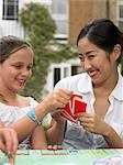 Girl and young woman playing board game Stock Photo - Premium Royalty-Free, Artist: Blend Images, Code: 6114-06610790