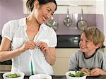 Young woman and boy preparing peas Stock Photo - Premium Royalty-Free, Artist: GreatStock, Code: 6114-06610797