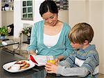 Exchange student and boy at breakfast Stock Photo - Premium Royalty-Free, Artist: GreatStock, Code: 6114-06610801
