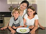 Young woman and children in kitchen Stock Photo - Premium Royalty-Free, Artist: GreatStock, Code: 6114-06610806