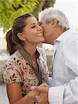 Man kissing woman on cheek Stock Photo - Premium Royalty-Free, Artist: Blend Images, Code: 6114-06610823