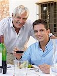 Father and son having a meal Stock Photo - Premium Royalty-Free, Artist: Cultura RM, Code: 6114-06610824