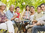Family in garden Stock Photo - Premium Royalty-Free, Artist: Blend Images, Code: 6114-06610831
