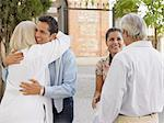 Family hugging Stock Photo - Premium Royalty-Free, Artist: Blend Images, Code: 6114-06610832