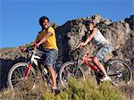 Two teenagers riding bicycles Stock Photo - Premium Royalty-Free, Artist: Aurora Photos, Code: 6114-06610854