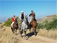 Three friends riding horses Stock Photo - Premium Royalty-Freenull, Code: 6114-06610863