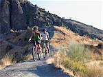 Two teenagers cycling Stock Photo - Premium Royalty-Free, Artist: Cultura RM, Code: 6114-06610864