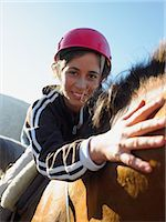 Young woman riding a horse Stock Photo - Premium Royalty-Freenull, Code: 6114-06610868