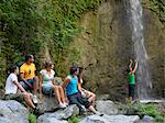 Teenagers sat next to a waterfall Stock Photo - Premium Royalty-Free, Artist: AWL Images, Code: 6114-06610883