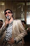 Retro man doing karaoke Stock Photo - Premium Royalty-Free, Artist: Westend61, Code: 6114-06610950
