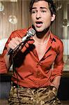 Young man singing karaoke Stock Photo - Premium Royalty-Free, Artist: Ikonica, Code: 6114-06610951