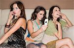 Young women with cellphones Stock Photo - Premium Royalty-Free, Artist: Blend Images, Code: 6114-06610965