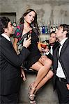 Sexy woman being adored by men Stock Photo - Premium Royalty-Free, Artist: Cultura RM, Code: 6114-06610972