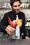 Bartender with cocktail Stock Photo - Premium Royalty-Free, Artist: Blend Images, Code: 6114-06610973