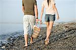 Couple walking along beach Stock Photo - Premium Royalty-Free, Artist: AWL Images, Code: 6114-06611027