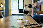 Man pouring red wine Stock Photo - Premium Royalty-Free, Artist: Yvonne Duivenvoorden, Code: 6114-06611047