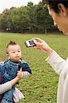 Father photographing son in park Stock Photo - Premium Royalty-Free, Artist: Aflo Sport, Code: 6114-06611075