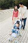 Parents with baby in a pram Stock Photo - Premium Royalty-Free, Artist: Steve McDonough, Code: 6114-06611103