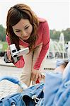 Woman filming her baby in pram Stock Photo - Premium Royalty-Free, Artist: Steve McDonough, Code: 6114-06611116