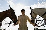 Young man with horses Stock Photo - Premium Royalty-Free, Artist: Minden Pictures, Code: 6114-06611208