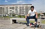 Young man with skateboard Stock Photo - Premium Royalty-Free, Artist: Cultura RM, Code: 6114-06611254