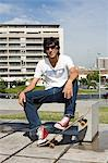 Young man with skateboard Stock Photo - Premium Royalty-Free, Artist: Cultura RM, Code: 6114-06611256