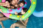 Friends playing in pool Stock Photo - Premium Royalty-Free, Artist: CulturaRM, Code: 6114-06611346