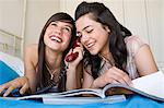 Teenage girls using telephone Stock Photo - Premium Royalty-Free, Artist: AWL Images, Code: 6114-06611369