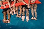 Friends floating in swimming pool Stock Photo - Premium Royalty-Free, Artist: Robert Harding Images, Code: 6114-06611380
