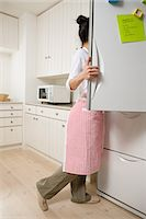 fridge - Woman looking in refrigerator Stock Photo - Premium Royalty-Freenull, Code: 6114-06611396