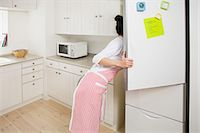 fridge - Woman looking in refrigerator Stock Photo - Premium Royalty-Freenull, Code: 6114-06611406