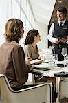 Couple ordering meal Stock Photo - Premium Royalty-Free, Artist: Westend61, Code: 6114-06611488
