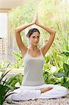 Woman in yoga posiiton Stock Photo - Premium Royalty-Free, Artist: Ikon Images, Code: 6114-06611539