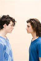 Young men face to face Stock Photo - Premium Royalty-Freenull, Code: 6114-06611571