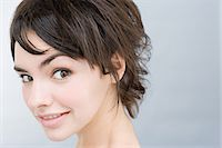 Face of a young woman Stock Photo - Premium Royalty-Freenull, Code: 6114-06611613