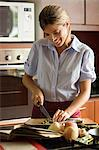 Woman preparing meal Stock Photo - Premium Royalty-Free, Artist: Cultura RM, Code: 6114-06611715
